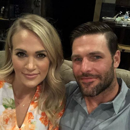 Mike Fisher with wife Carrie Underwood